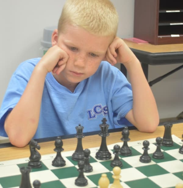 LCS student playing a game of chess