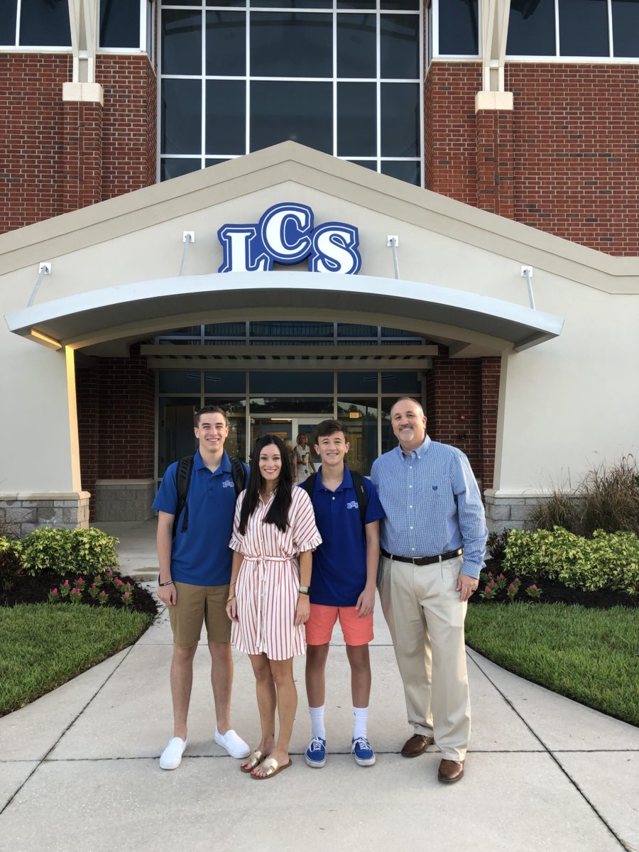 Copeland family in front of LCS on first day of school